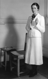1st April 1936: English aviator Amy Mollison, nee Johnson (1903 - 1941) wearing a woollen suit from the collection of flight clothes designed by Madame Schiaparelli for her solo flight from London to Cape Town.